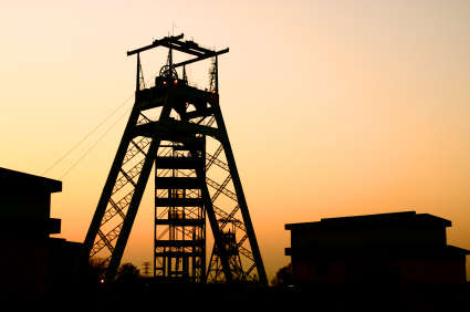South African Gold mine head gear in a sunrise silhouette