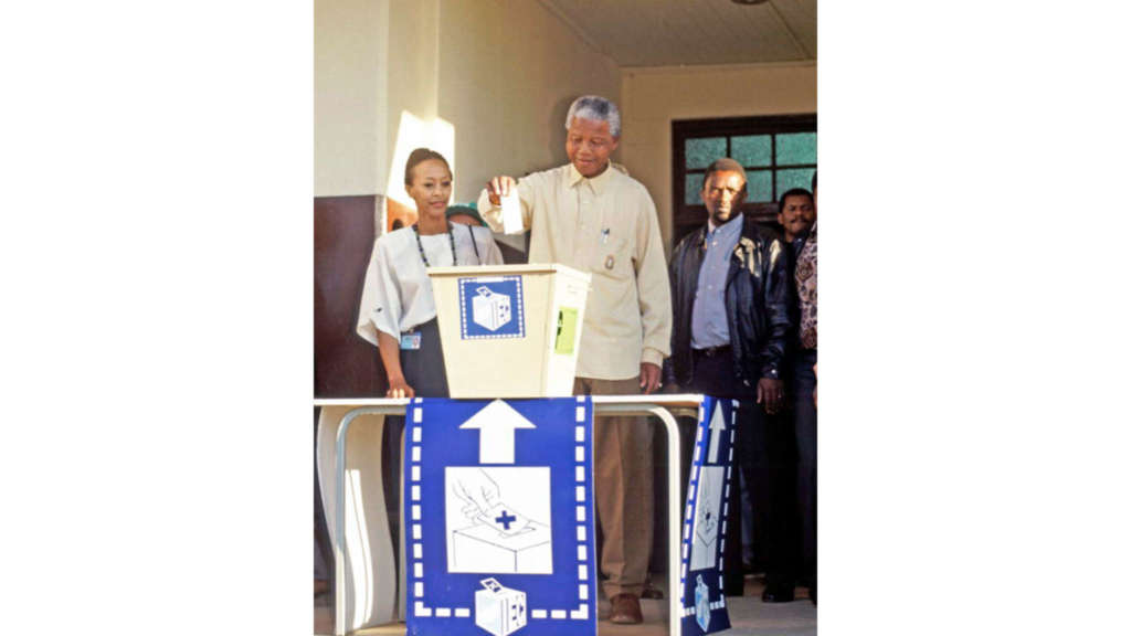 Nelson Mandela casting the ballot in his country's first all-race elections at Ohlange High School near Durban. Credit: UN Photo/Chris Sattlberger